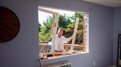 Champion installer removing old window frame