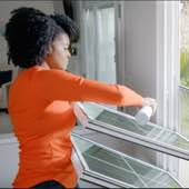 Woman cleaning Champion Windows