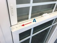 Latches (A) are located on the top corners of the bottom sash.