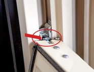 Pivot bars (B) are located on the window sash