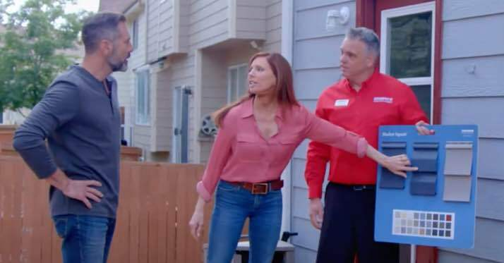 Champion employee showing siding options to customers