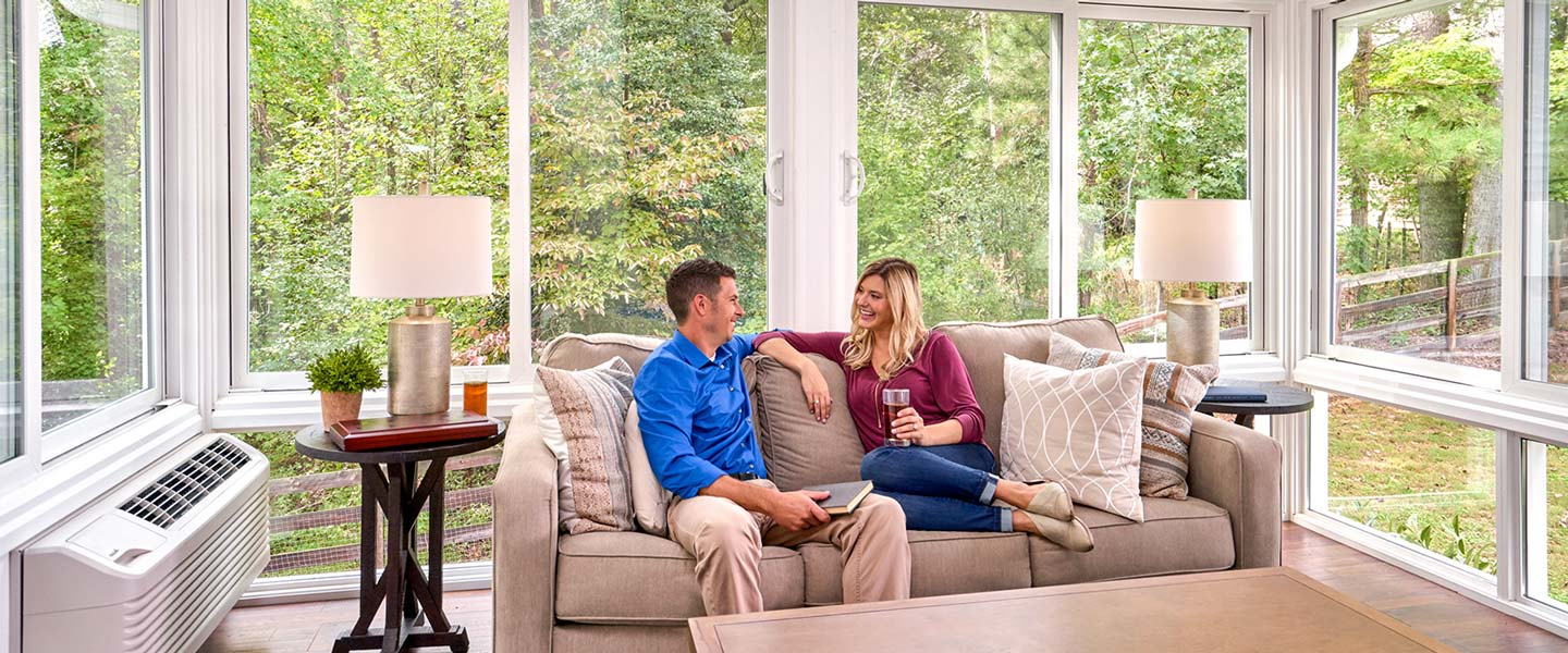 Family relaxing in Champion All-Season sunroom
