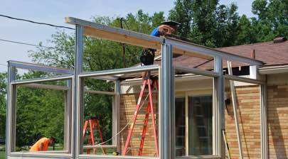 Champion installer working on longer sunroom installation process