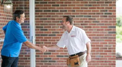 Champion installer greeting customer