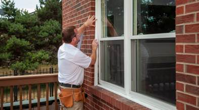 Champion installer sealing the edges of a window
