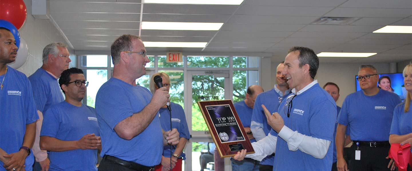 Champion CEO Todd Dickson handing out award to employees