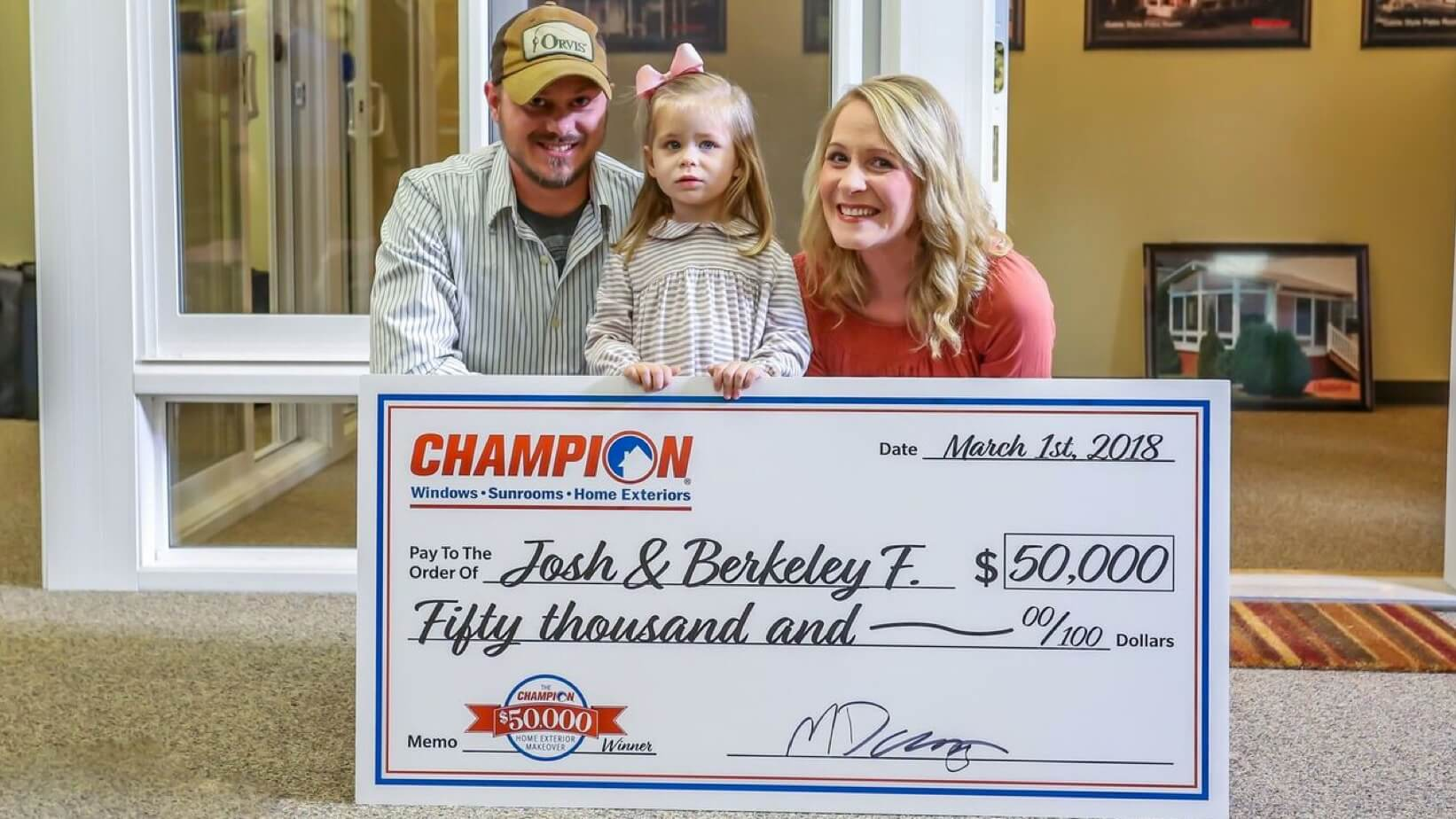 Champion contest winners with check