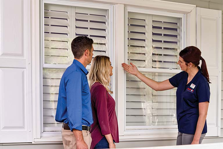 Champion employee showing customers window options